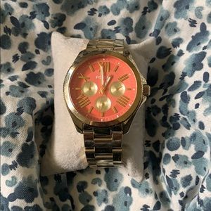 Fossil watch with pink face